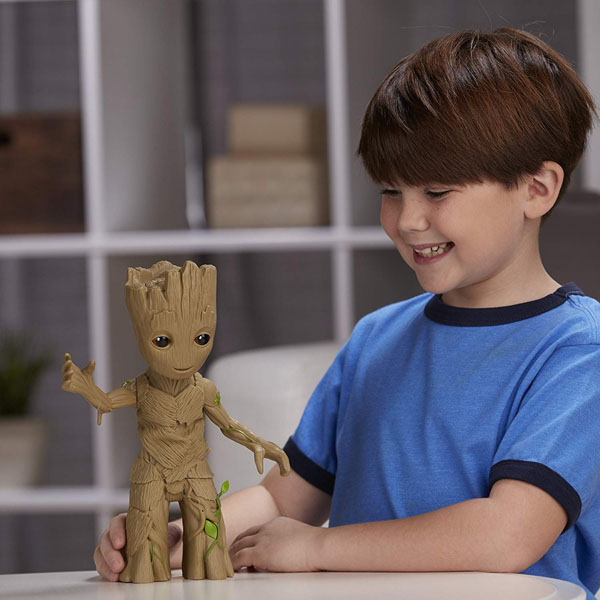 Child playing with Dancing Baby Groot figure