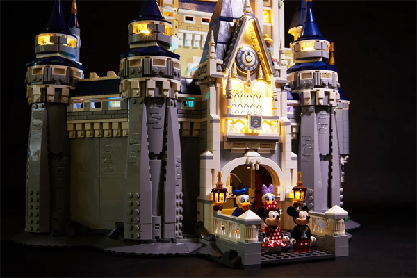 Minnie, Mickey, Donald, Daisy, in the Lit up Lego Disney Castle